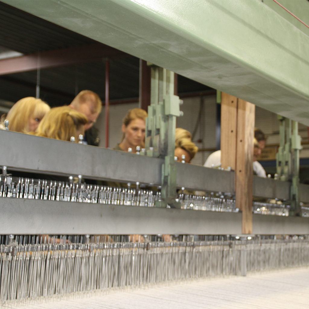 A look into the heart of the machine: the combs, warp and weft